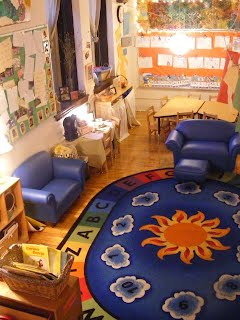 Each classroom has a large meeting space, which commonly has a large rug/carpet as well as soft furniture.